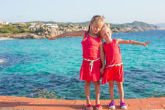 Adorable little girls at tropical beach during Stock Photography