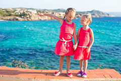 Adorable little girls at tropical beach during Royalty Free Stock Photo