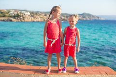 Adorable little girls at tropical beach during Stock Photos