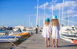 Adorable little girls walking in a port on summer Royalty Free Stock Image