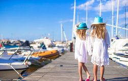 Adorable little girls walking in a port during Stock Image