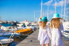 Adorable little girls walking in a port during Royalty Free Stock Image