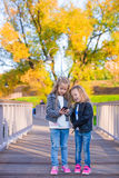Adorable little girls at warm autumn day outdoors Stock Photography