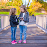 Adorable little girls at warm autumn day outdoors Stock Photos