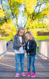Adorable little girls at warm autumn day outdoors Royalty Free Stock Photography