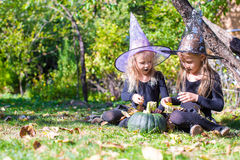 Adorable little girls in witch costume casting a Royalty Free Stock Images