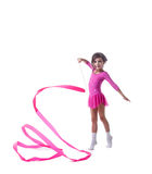 Adorable little gymnast dancing with ribbon Stock Photo