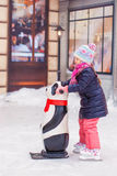 Adorable little happy girl skating on the ice-rink Royalty Free Stock Photo