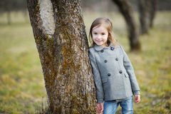 Adorable little having a walk in beautiful park Stock Image