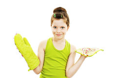 Adorable little housewife with oven mittens and dishcloth Royalty Free Stock Image