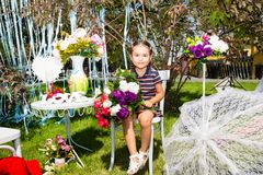 Adorable little kazakh, asian child girl on summer green nature background. Flower concept and kid Stock Photography