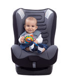 Adorable little kid sitting in a car seat Stock Image