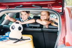 adorable little kids in car going stock photography