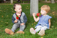 Adorable little kids with colorful lollipops Stock Images