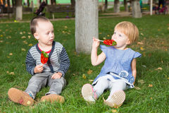 Adorable little kids with colorful lollipops Royalty Free Stock Photo