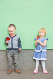 Adorable little kids with colorful lollipops Stock Photography