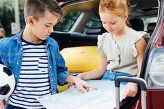 Adorable little kids with map. On car trip royalty free stock image