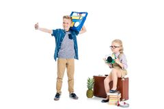 adorable little kids with various objects taking selfie with smartphone stock photography