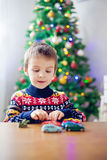 Adorable little preschool boy, playing with toy cars at home on Stock Images