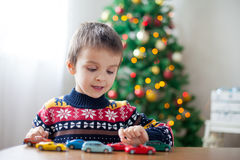 Adorable little preschool boy, playing with toy cars at home on Royalty Free Stock Images