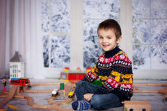 Adorable little preschool boy, playing with wooden trains and ra Royalty Free Stock Images
