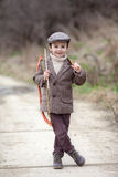 Adorable little preschool boy, shoot with bow and arrow at targe Royalty Free Stock Image