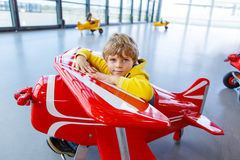 Adorable little preschool kid boy driving toy old vintage pedal Royalty Free Stock Photos