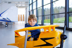Adorable little preschool kid boy driving toy old vintage pedal Stock Photo