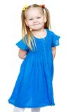 Adorable little round-faced girl with pigtails on Stock Photography