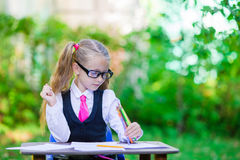 Adorable little school girl outdoor. Back to Stock Photography