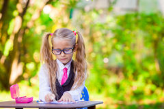 Adorable little school girl outdoor. Back to Stock Photo