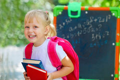 Adorable little schoolgirl. Feeling extremely excited about going back to school Stock Photo