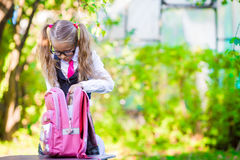 Adorable little schoolgirl with a backpack going Royalty Free Stock Photography