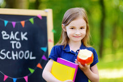 Adorable little schoolgirl is going back to school Stock Photos