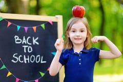 Adorable little schoolgirl is going back to school Royalty Free Stock Photos