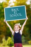 Adorable little schoolgirl going back to school. Adorable little schoolgirl feeling very excited about going back to school Stock Photos