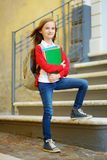 Adorable little schoolgirl studying outdoors on bright autumn day. Young student doing her homework. Education for small kids. Royalty Free Stock Images
