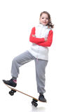 Adorable little skateboarder isolated on white Stock Photography