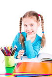 Adorable little girl drawing in a sketchbook with colored pencils Royalty Free Stock Photo
