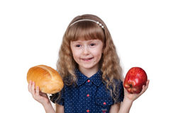 Adorable little smiling girl with red apple and bread isolated Royalty Free Stock Images