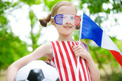 Adorable little soccer fan cheering Royalty Free Stock Photo