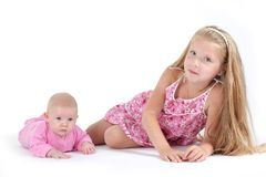 Adorable little two sisters 8 year and 3 month Royalty Free Stock Photos
