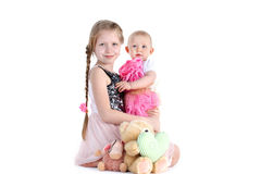 Adorable little two sisters 8 year and  11 month Royalty Free Stock Image