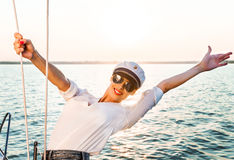 Adorable model wearing sea admirals hat and sexy top at sunset. Stock Photography