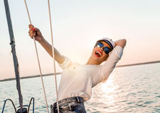 Adorable model wearing sea admirals hat and sexy top at sunset. Stock Images
