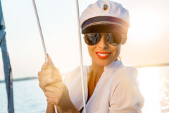 Adorable model wearing sea admirals hat and sexy top at sunset. Royalty Free Stock Image
