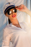 Adorable model wearing sea admirals hat and top at sunset. Stock Images