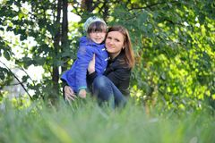 Adorable mother and daughter on green background Stock Photography