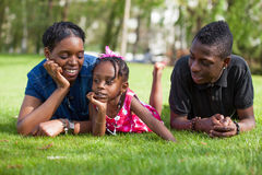 Adorable mother with her childrens in the garden Stock Images