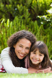 Adorable mother with her daughter in the garden Royalty Free Stock Photography